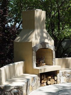 "36"" Stone Age stucco fireplace with seatwalls."