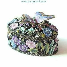 Butterfly Flowers Box Swarovski Crystals 24K Gold Jewelry, Trinket, Pill Box FIGURINE Dazzlers. $36.95. Opens to reveal a storage compartment that's completely finished in a glossy enamel.. Arrives in a padded, satin lined Presentation Box. 100% Satisfaction Guaranteed by this bonded seller.. Set with sparkling Swarovski Crystals and meticulously hand enameled by skilled artisans.. Certificate of Authenticity included. Limited edition item which is sure to grow in va... Butterfly Flowers, Butterflies, Jewelry Dish, Jewelry Box, 24k Gold Jewelry, Clay Figurine, Little Boxes, Pill Boxes, Flower Boxes