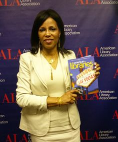 Ilyasah Shabazz, community organizer, activist, author, and daughter of civil rights leaders Malcolm X and Dr. Betty Shabazz, holds an American Libraries issue at the 2014 ALA Annual Conference in Las Vegas.