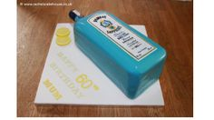 Bombay Sapphire Gin Bottle cake, Madeira cake with layers of vanilla buttercream and homemade raspberry jam. Decorated with a hand painted label and icing lemon slices on the side.