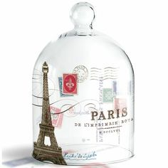 """Would love to have one of these! Beautiful petite glass cloche by Fringe Studio features a stylish design with the Eiffel Tower with a vintage postal motif with the word PARIS, along with French script. The image is transferred onto the surface of the glass, making these cloches wonderfully unique and beautiful. These small cloches measure 8"""" tall by 5"""" wide and can fit over very small candles and trays."""