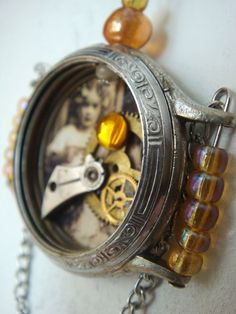 Old watch collage pendant.