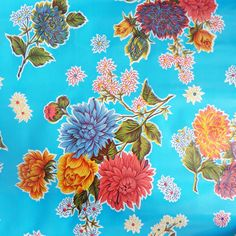 Mexican Oilcloth in Light Blue ChrysanthemumWidth:120cmIf you require more than 6 metres please order two lengths.  Oilcloth will be sent in one continous piece up to a maximum length of 10metres.Full rolls available (10.9metres) please email for details.