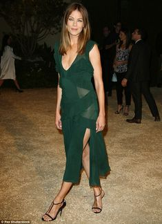 Dare to go bare: Michelle Monaghan opted not to wear undies with her green dress as sheer panels revealed when she stepped out toBurberry's London In Los Angeles show  at the Griffith Observatory on Thursday