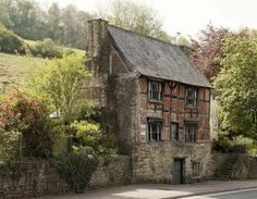The Old House, Lower Lydbrook, Gloucestershire, England. Just a short walk from the beautiful River Wye on the England/Wales border is this very picturesque cottage standing above the main street through Lower Lydbrook. It dates from the 16th century but could be much older. The Old House, also called Sarah Siddons House, dates from the 16th century. The early 18th century extension (dated 1718) is behind the steps. The Old House was Grade II* listed in 1953.