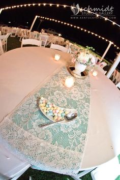 Lace table runners over colored linen