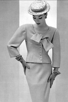 1954 Lucky is wearing two-piece suit with the new short jacket in pastel wool by Balenciaga, photo by Pottier