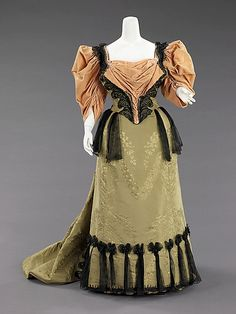 Circa 1893 dress by House of Worth, French. Like the wisps of black material hanging from the hem and waist. (Bodice 2 of 2)