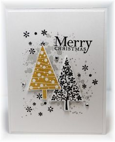 Scrappin' and Stampin' in GJ:  The background splotches are smoky slate, the snowflakes are black.  The trees are stamped with honey and black, punched out and popped up.