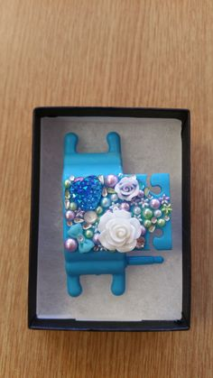Blue Phone Buddy with white rose, blue heart, flowers, bows and gems. Why not create your own www.phone-buddy.co.uk Create Your Own, Create Yourself, White Roses, Birthday Candles, Gems, Phone, Heart, Frame, Flowers