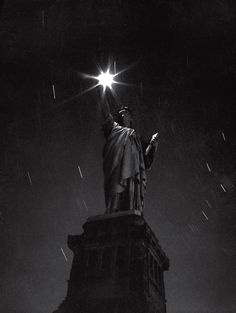 The Statue of Liberty, photographed during a blackout in 1942 — an eloquent expression of the nation's mood in the first full year of a global conflict with no real end in sight. | LIFE in World War II: The Photos We Remember