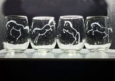 """Set of unique, bubble-infused stemless wines, hand-etched with a different one of my """"horse play"""" images.  Makes a fab gift for any horse enthusiast (dressage, western reining, team roping, saddleseat, hunter jumper, quarter horses, warmbloods, eventing, etc!)   And stemless wines can be used for serving a multitude of beverages and even be used for votive candle holders!"""
