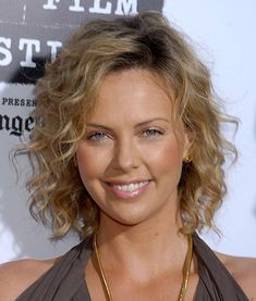 Charlize Theron's wavy bob. http://beautyeditor.ca/2013/10/03/curly-fine-hairstyles