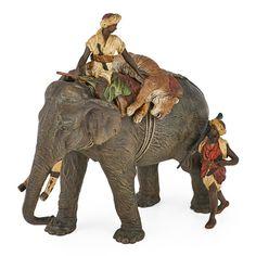 Franz Xaver Bergmann - Cold-painted bronze figure of elephant and huntsmen with tiger. Price Estimate: $2,000 - $3,000. Winning bid: $13,750