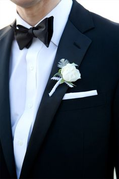 classic white groom's wedding boutonniere on a tuxedo, photo by Karen HIll Photography