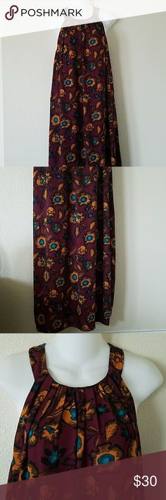 Colorful floral halter maxi dress sz M Colorful floral halter maxi dress in a wine color size medium. Sleeveless, zips in the back, with a slit in the back, airy and flowy. In excellent used condition. Everly Dresses Maxi