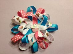 Flower style hair bow with cup cakes
