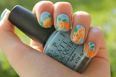 OPI What's with the cattitude? and orange, green and white nail polish.  www.coewlesspolish.wordpress.com   http://weheartnails.com/