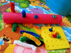 toddler activity- poking into pool noodle