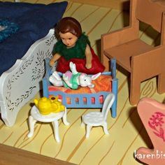 Doll playing with her dolls in dollhouse.  #dollhouse #dollhouseminiatures #dockskap #dockskåp #dukkehus #miniatures #decorationlivingroom #chrismasdecorate #dollhousefurnitures #dukkehusmøbler