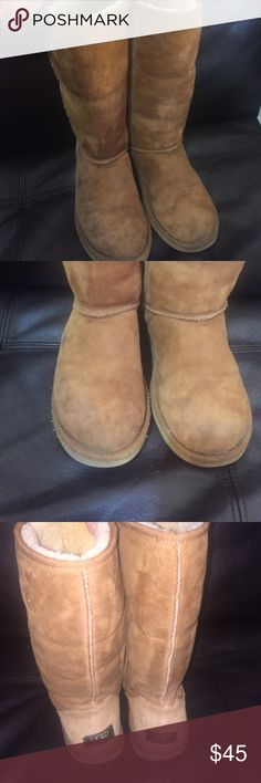 Tall classic UGG AUSTRALIA 💯%authentic , tall classic UGG's , gently used ,have wear on far corners of both soles  , for that these boots are marked down in the price , every thing else still in great condition , no hole ,rip or snow damaging stains , trust me they Are ready to give the love and warm you looking for this winter , these are  soft and Cosy , beautiful chestnut color fresh and clean absolutely no odor ,size 7  must be at least 7.5 with socks to fit , 8 can be good too but not…