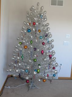 """Aluminum Christmas Tree - Gladys and Cloyd had one of these with a """"color"""" wheel. Retro Christmas Tree, Merry Christmas Baby, Silver Christmas Tree, Christmas Scenes, Christmas Past, Vintage Christmas Ornaments, Holiday Tree, Modern Christmas, Christmas Tree Decorations"""