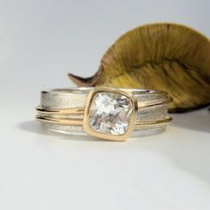 White Topaz banded ring with burr satin finish Gold And Silver Rings, Satin Finish, White Topaz, Band Rings, Wedding Rings, Engagement Rings, Jewelry, Rings For Engagement, Jewlery
