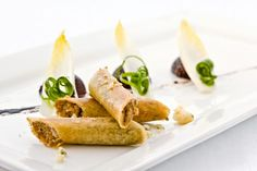 Duck rillettes with parsnip mousseline, mizuna, and wine-poached apples from…