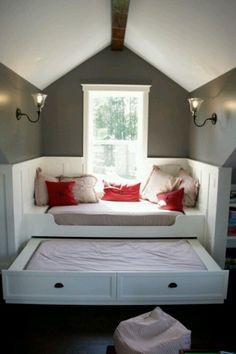 Treat a window seat like its own little room with panelling and light fixtures. This window seat obviously moonlights as a guest bedroom with a trundle bed and pillows that are part and parcel of the bedding. Decor, Attic Bedroom Designs, Home Projects, Built In Bed, Home, Small Spaces, House, Bedroom Design, Cool Bunk Beds