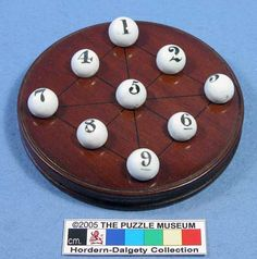 Century mahogany board with ceramic numbered balls. The object is to arrange the balls so that the total value of every line (Vertical, Horizontal & Diagonal) adds to the same total. manufactured by John Jaques and Co. Magic Squares, Cooking Timer, 19th Century, Balls, Objects, Ceramics, Board, Ceramica, Pottery