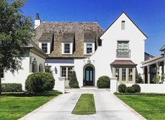 Love everything going on here from the dormers to the arched front entrance down to the driveway! Stucco Homes, Paint Colors For Living Room, Facade House, Classic House, House Goals, Residential Architecture, My Dream Home, Dream Homes, Architecture Details