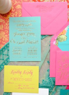 If you love bright, bold colors and shiny gold foil, you'll love these wedding invitations! A collaboration between calligrapher Jenna Blazevichand designer/printer Margot Madison, the invitation suite features bright jewel tones paired with both gold foil and shiny metallic gold ink, a colorful floral envelope liner, and lots of pretty day-of stationery details!