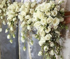 Beautiful cream roses, buds , gold spray , gyp and misty teardrop cascading bouquets