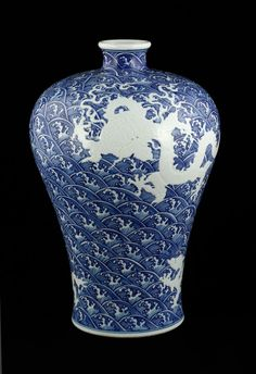 """Blue and white dragon Mei vase, China, decorated with flying white dragons amidst blue waves,15 1/4"""" h."""