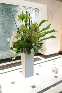 Clean, modern, green and white large centerpiece reception wedding flowers, wedding decor, wedding flower centerpiece, wedding flower arrangement, add pic source on comment and we will update it. www.myfloweraffair.com can create this beautiful wedding flower look.