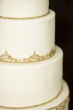 The Cake Flower | Ivory and Gold Wedding Cake. Filigree was hand-piped with royal icing and then hand-painted with Rolkem Super Gold mixed with vodka.