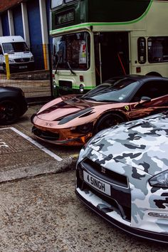 Rose gold Ferrari and Grey Camouflage Nissan GTR
