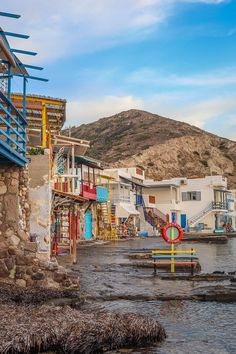 A guide to everything you need to know about visiting Klima village in Milos, including lots of photos plus tips on where to eat and where to stay. Click through for the full guide! Most Beautiful Greek Island, Best Greek Islands, Solo Travel Tips, Fishing Villages, Day Trips, Travel Guides, Playground, Places To See, Adventure Travel
