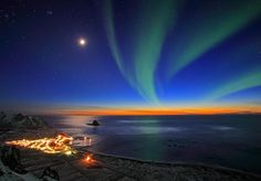 Norther lights and sunset in the village of Bleik (Norway)