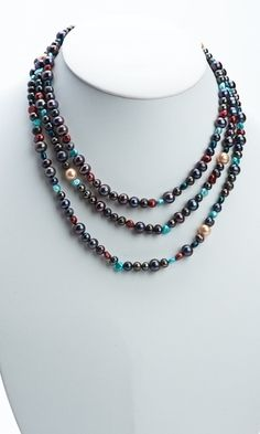 Black and Jewel Toned Triple Strand Pearl Necklace. http://store.nightlightinternational.com/product_p/p018n.htm $64.99. For Freedom's Sake.