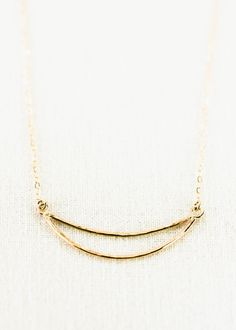 Hilo (HEE loh) - new moon.    Beautiful, delicate, gold crescent necklace. This modern crescent moon necklace makes a stunning statement for
