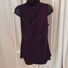 Silk purple Banana Republic blouse size m Good used condition.  Has twist feature on front. Banana Republic Tops