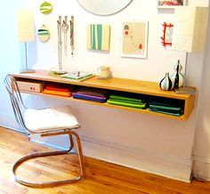 Why couldn't this be mounted underneath a writing table.  Seems like a good way to hide the mess at the end of day.  18 DIY Desks to Enhance Your Home Office