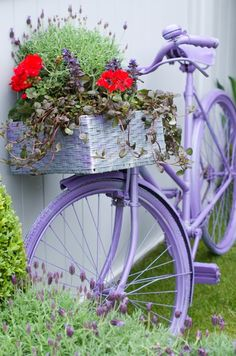 Lilac bicycle with flowers.