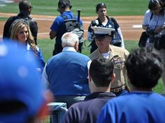 Tommy Lasorda greets the Veteran of the Game, Sergeant Eric Rodriguez. Rodriguez, who lost a leg to an IED in Afghanistan, is currently more active than most who were in attendance at Dodger Stadium, and plans to return to Afghanistan.