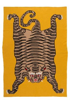 The auspicious Caspian tiger celebrated in Mongolian and Tibetan traditions adorns the Tiger Rug throw. Vibrant in color and fierce in design, the weave is a luxurious pairing of Mongolian Cashmere and fine Baby Camel Hair. Tiger Blanket, Tiger Rug, Caspian Tiger, Baby Camel, Cashmere Throw, Bed Linen Design, Kids Blankets, Textiles, Linen Bedding