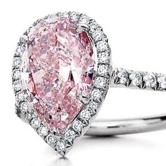 The classic pear shape goes ultra-romantic in a pink diamond ring.