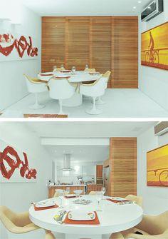A porta de correr com quatro folhas, feita de peroba-mica, integra as diferentes áreas deste apartamento. Aberta, ela permite o acesso à cozinha, onde se encontra a bancada de peroba com tampo de aglomerado branco.