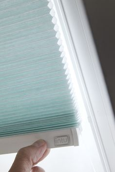 Blue pleated Intu blinds from Apollo Blinds.