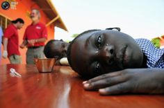 A girl with hearing challenges cries after her ears were cleaned during an event held by Starkey Hearing Foundation at St. Monica in Gulu. STRINGER/REUTERS